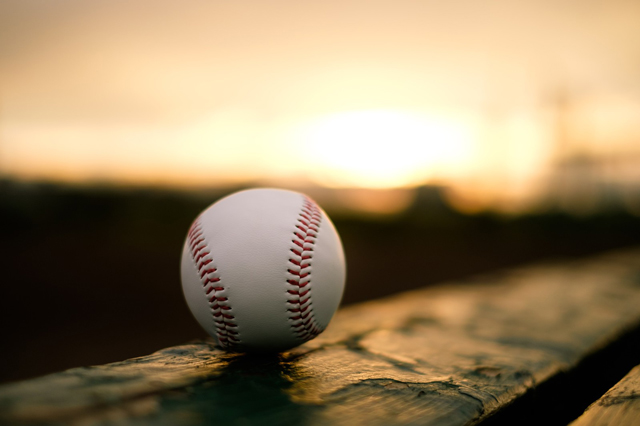 Baseball at sunset.