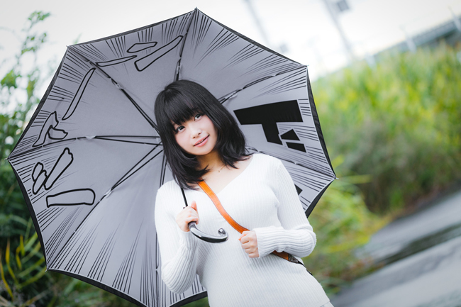 Japanese girl, with katakana-print umbrella.