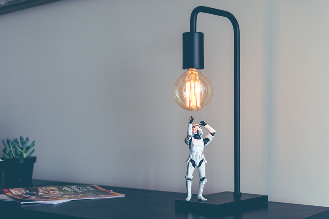 Stormtrooper having an idea while standing under a lamp.
