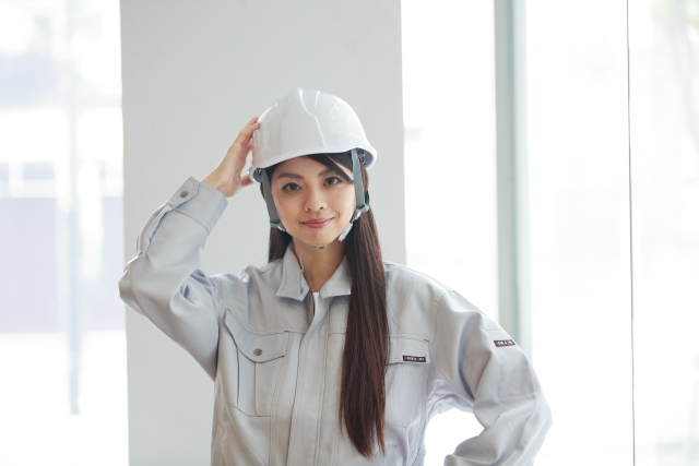 Female construction worker wearing a helmet.