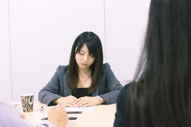 Woman sleeping in meeting.