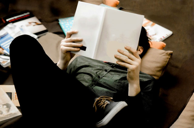 Young man reading a book.
