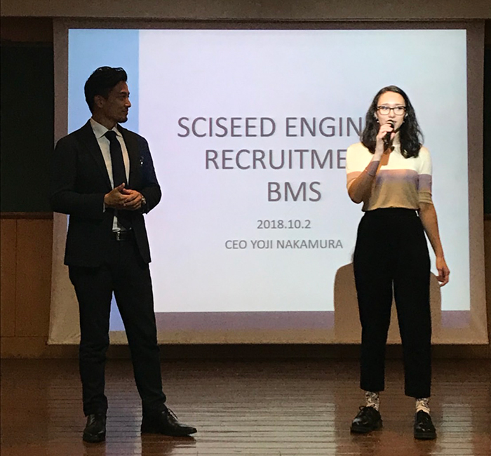 Picture of Chloe interpreting at a recruitment event in India.